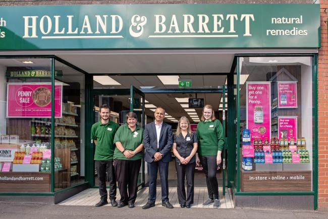 Holland and Barrett store with staff proudly in the doorway